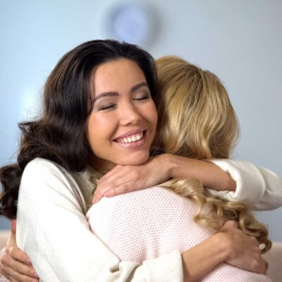 Two women hug after discussing ARMS Share Hope IVF Discount Program | Arizona Reproductive Medicine