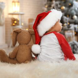 Baby in Santa hat with teddy bear | Arizona Reproductive Medical Specialists