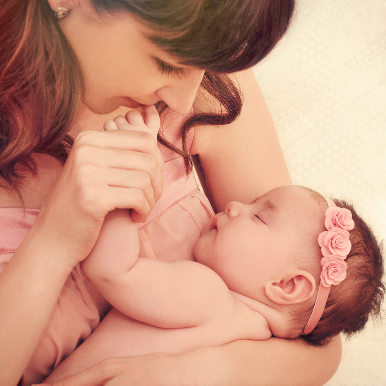 woman holds baby after pregnancy from IVF Guarantee   Arizona Reproductive Medicine Specialists   AZ